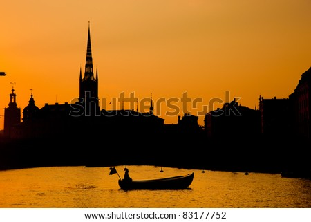 Romantic city of Stockholm, Sweden at sunset. Boat and architecture - stock photo