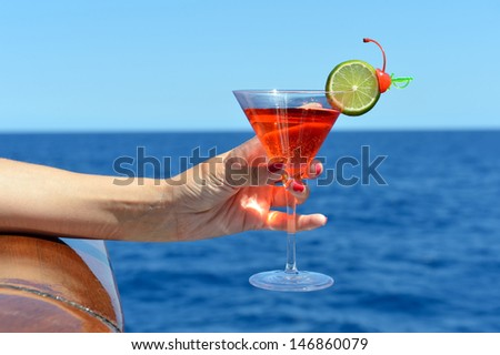 Romantic cocktail at sea cruise - stock photo