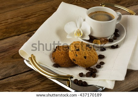 Romantic coffee cup served with white orchid. Morning coffee cup. Cup of strong coffee on the serving tray.  - stock photo