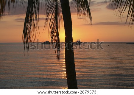 Romantic colorful sunset from a beach in Jamaica - stock photo