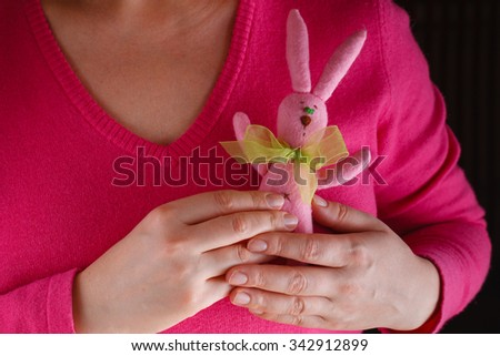 Romantic concept. Female in pink with soft bunny toy