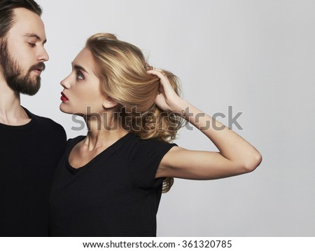 Romantic couple.beautiful woman and handsome man.lovely boy and girl.kiss.Saint Valentine's Day.Heart tattoo - stock photo