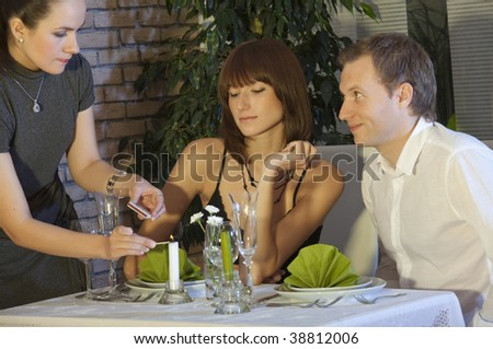 romantic couple by candlelight dinner in a restaurant - stock photo