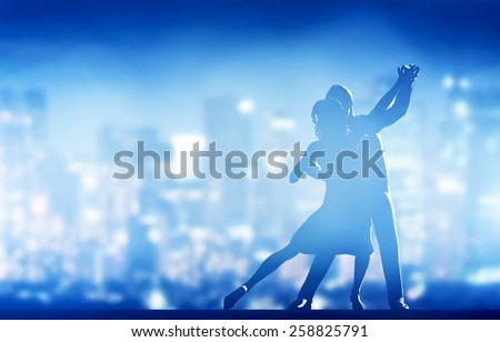 Romantic couple dance. Elegant classic pose. City nightlife background - stock photo