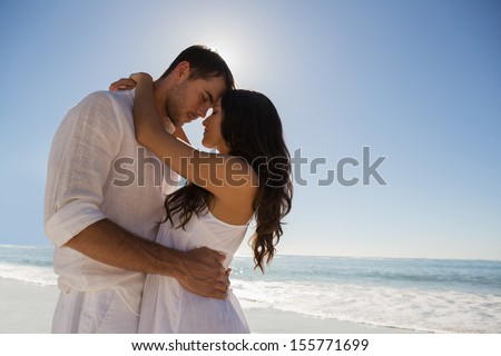 Romantic couple embracing  at the beach - stock photo