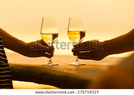 Romantic couple enjoying a glass of white wine.  - stock photo