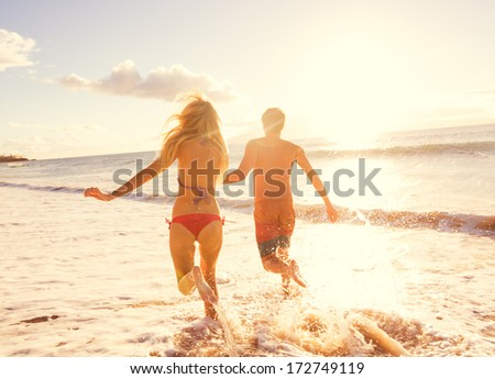 Romantic Couple Enjoying Sunset on Beautiful Tropical Beach - stock photo