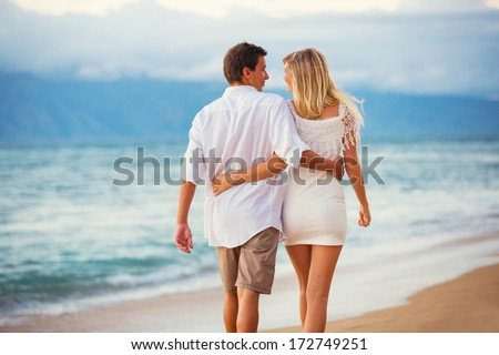 Romantic Couple Enjoying Sunset on Beautiful Tropical Beach