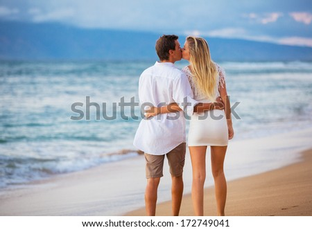 Romantic Couple Enjoying Sunset on Beautiful Tropical Beach, Love Honeymoon Concept