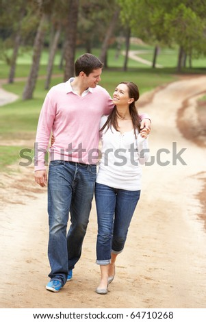 Romantic couple enjoying walk in park