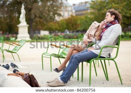 Romantic couple having a date in the Tuilleries garden of Paris - stock photo
