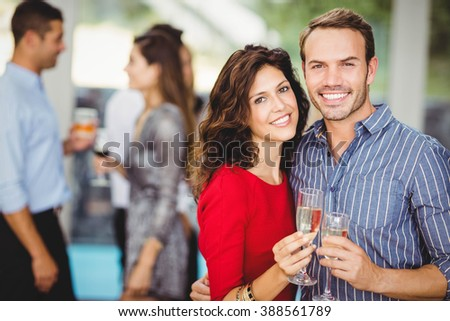 Romantic couple having drinks at the party - stock photo