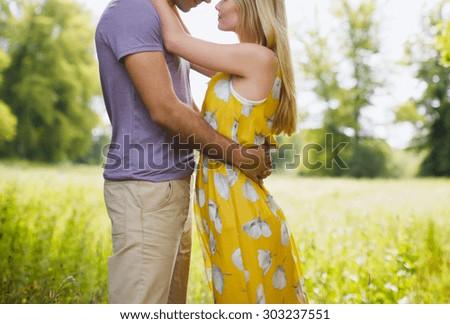 Romantic Couple In Field - stock photo