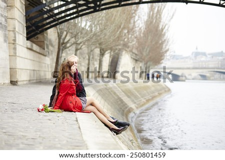 Romantic couple in love having a date near Pont des Arts in Paris - stock photo