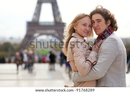 Romantic couple in Paris by the Eiffel Tower - stock photo