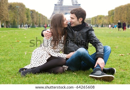 Romantic couple in Paris, near the Eiffel Tower - stock photo