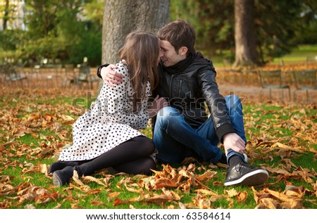 Romantic couple in park at fall - stock photo