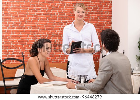 romantic couple in restaurant - stock photo
