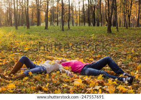 romantic couple in the autumn park - stock photo