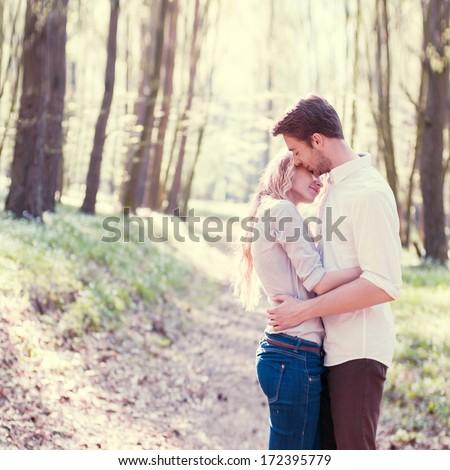 romantic couple in the woods - stock photo