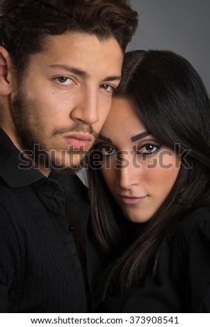 Romantic couple intimate studio portrait. - stock photo