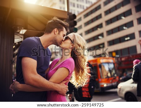 romantic couple kissing in down town los angeles - stock photo
