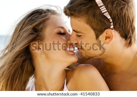 Romantic couple kissing on the seaside - stock photo