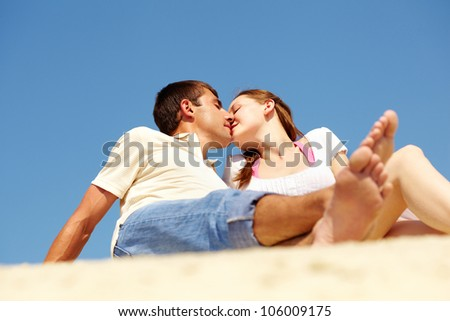 Romantic couple kissing outside on a sunny summer day - stock photo
