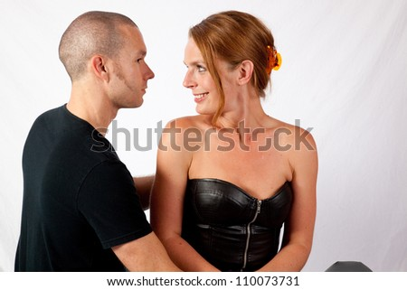 Romantic couple, man and woman looking lovingly into each others eyes - stock photo