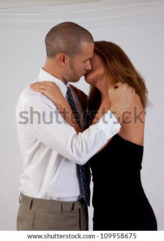 Romantic couple, man and woman, standing in an embrace and close to a kiss - stock photo