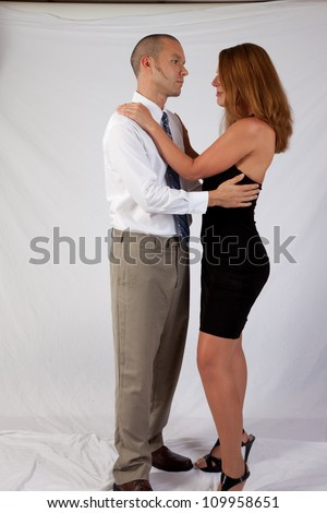 Romantic couple, man and woman, standing in an embrace and staring into each others eyes - stock photo