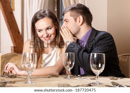 Romantic couple on a date in restaurant - stock photo