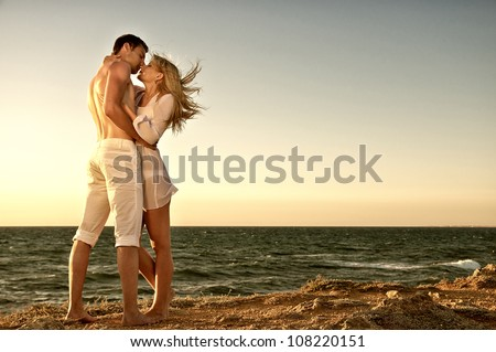 Romantic couple on the beach - stock photo