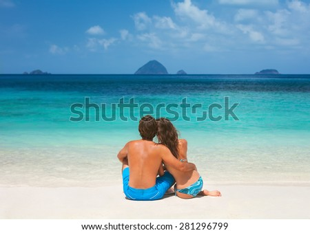 Romantic couple on the tropical  beach on the sea - stock photo