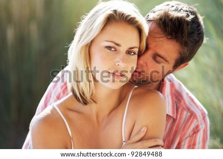 Romantic couple outdoors - stock photo