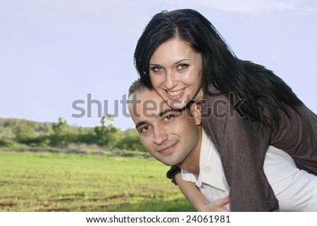 Romantic couple playing and embracing at nature - stock photo