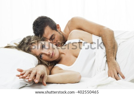 romantic couple sleeping in a white bed - stock photo