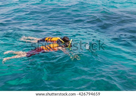 Romantic couple snorkeling in andaman sea at phi phi islands, Thailand.