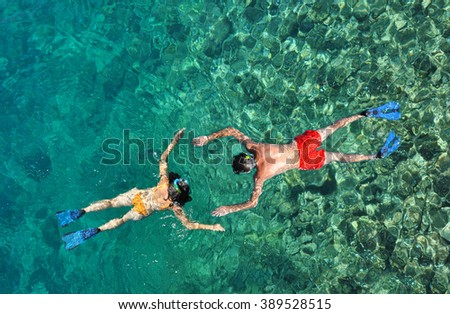 Romantic couple snorkeling in the sea - stock photo