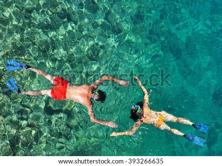 Romantic couple snorkeling in the sea - stock photo