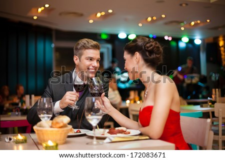 Romantic couple toasting  to own love - stock photo