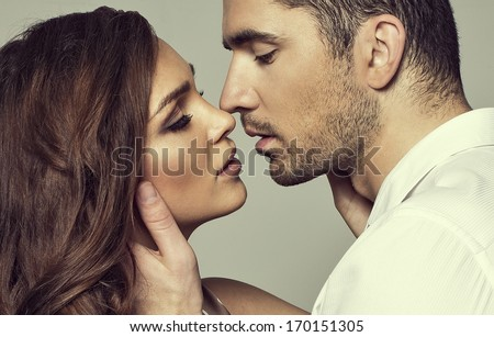 Romantic couple touching and kissing each other - stock photo