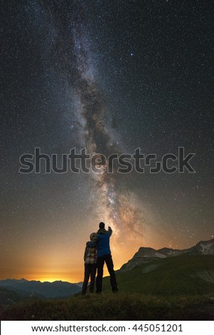 Romantic couple under the stars and embrace together, Milky Way, look in the starry sky, inspiration photo, unity the man and nature, astronomy and astrophotography