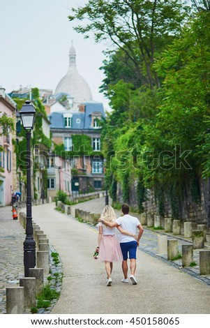 Romantic couple walking on Montmartre in Paris, France - stock photo