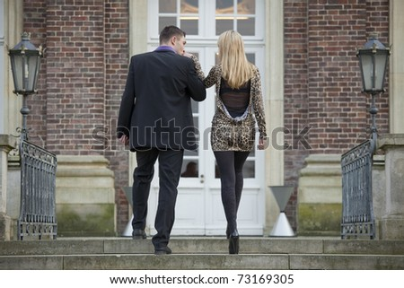 romantic couple walking on stairs - shot from behind