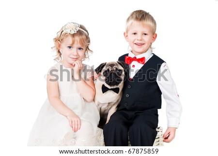 romantic couple with puppy over white - stock photo