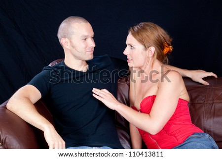 romantic couple, with the woman working on seducing the man, with love in her eyes