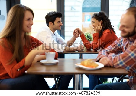 Romantic couples having a date in cafeteria. - stock photo