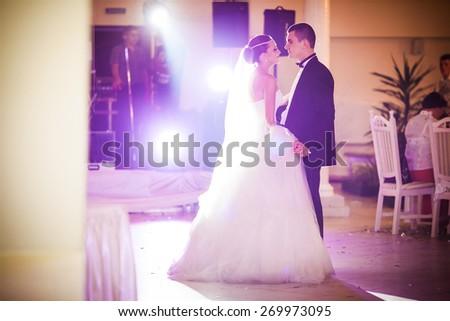 romantic dance by wedding couple - stock photo