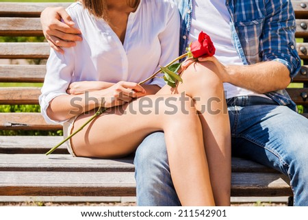 Romantic date. Close-up of loving couple bonding to each other while sitting on the  - stock photo